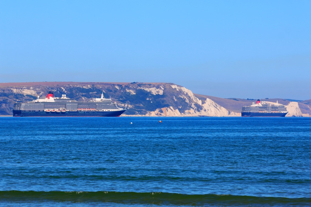 Fleet mates Queen Elizabeth and Queen Victoria seen anchored of Weymouth last year.